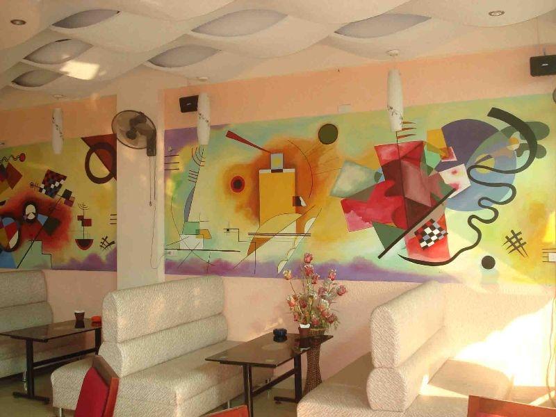 3 lí do nên trang trí quán cafe bằng tranh tường